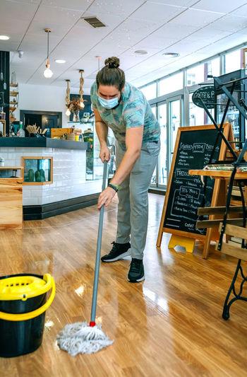 Man standing on hardwood floor