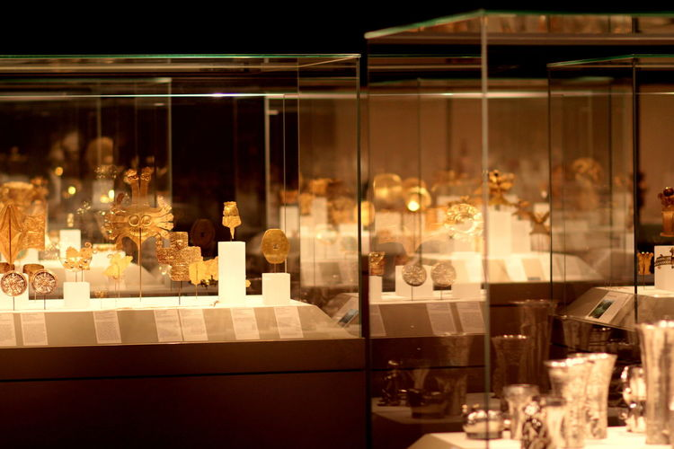 Art Artifacts Collection Display Glass Gold Illuminated In A Row Museum Rare Tresure Underground
