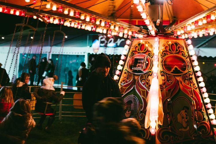 The dark carnival Illuminated Night Men Travel Destinations Women Outdoors Carousel Large Group Of People Christmas Market Real People Amusement Park People Adults Only Adult 12daysofeyeem EyeEm Best Shots The Week On EyeEm