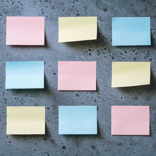 Blank colorful adhesive notes on wall