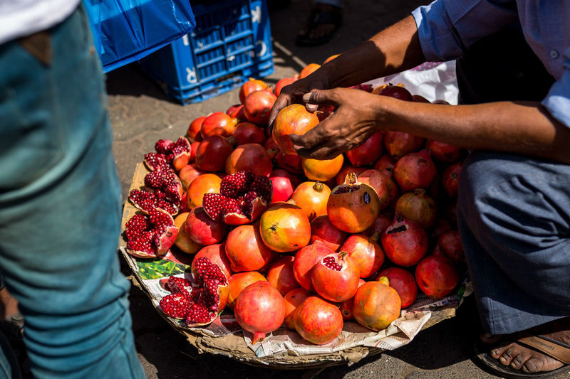 Low Section Of Vendor Selling Fruits At Market