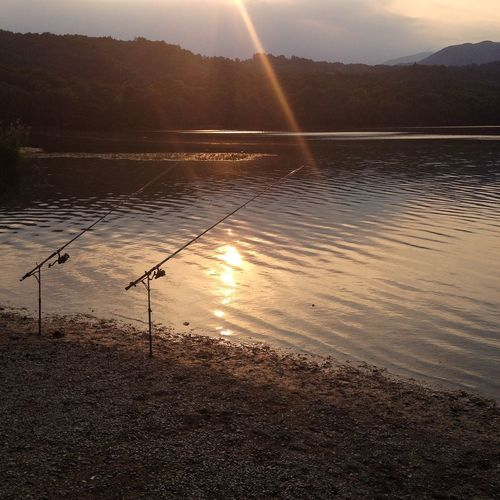 Fishing rods at sunset Enjoying The Sun Peace And Quiet Quality Time Beauty In Nature Lake Piedmont Lago Piccolo Di Avigliana Sunrays Outdoor Sport