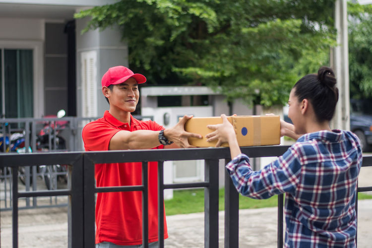 Boys Cap Casual Clothing Child Childhood Day Focus On Foreground Holding Innocence Leisure Activity Lifestyles Males  Men Outdoors People Real People Standing Teenager Togetherness Two People Waist Up Young Men