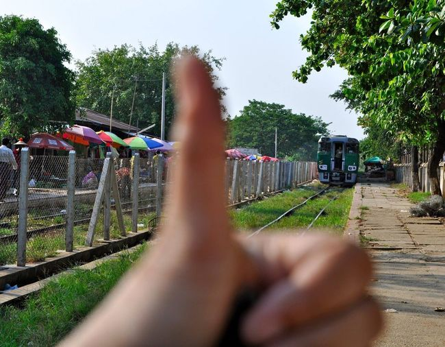 Myanmar's Circle Train Yangon, Myanmar Circle Train Plant Tree Real People Nature Day Human Hand Human Body Part Finger Barrier Outdoors People Boundary Hand Fence Lifestyles Sky Personal Perspective