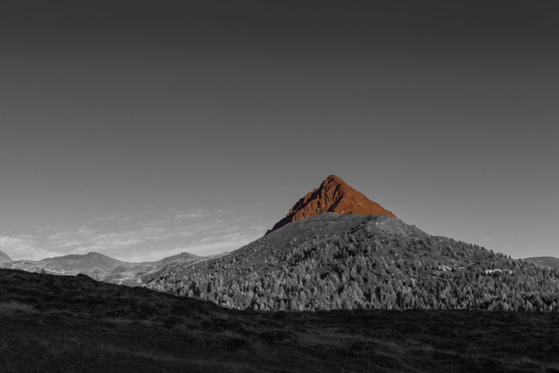 Color isolation effect on top of a volcano-shaped mountain, col quaterna, dolomites, veneto, italy