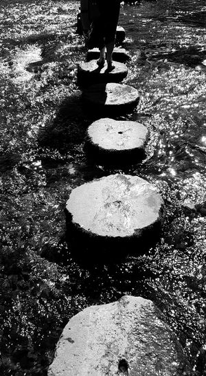 Crossing Low Section Person Lifestyles Sunlight Human Foot Day Outdoors Footpath Stone Material Crossing Crossing Rivers Stepping Out