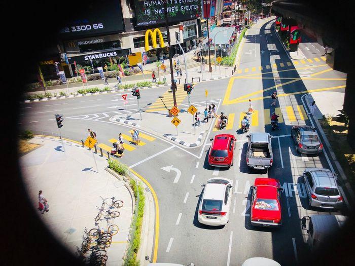 Hustle bustle of Kuala Lumpur city Malaysia Kiala Lumpur , Bukit Bintang , Malaysia , Traffic , Vehicle , Aerialview , IphoneX Cars High Angle View Street Road Car Day Outdoors People City