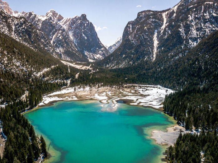Mountain Scenics - Nature Beauty In Nature Water Tranquil Scene Tranquility Lake Non-urban Scene Sky Nature Mountain Range Turquoise Colored Idyllic Day Environment No People Remote Cold Temperature Green Color Snowcapped Mountain Swimming Pool Mountain Peak