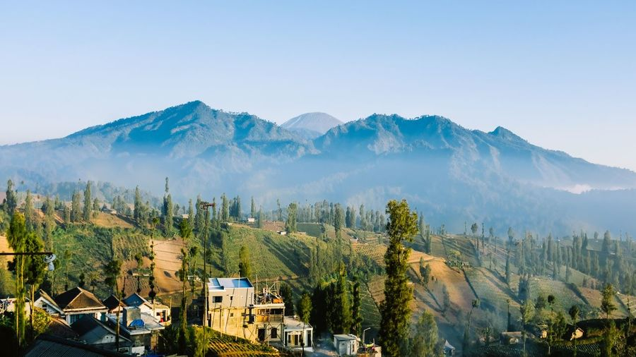 Panoramic shot of townscape against mountain range