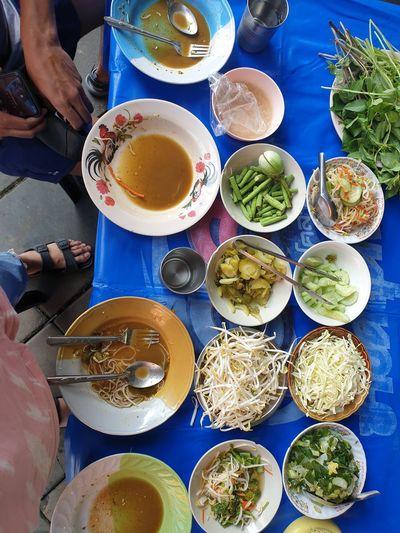 High angle view of people having food
