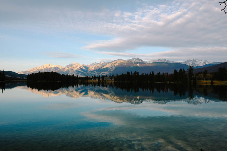 Scenics - Nature Beauty In Nature Sky Water Tranquil Scene Lake Tranquility Mountain Cloud - Sky Reflection Non-urban Scene Idyllic Mountain Range Nature Waterfront No People Remote Tree Environment Outdoors Snowcapped Mountain Reflection Lake