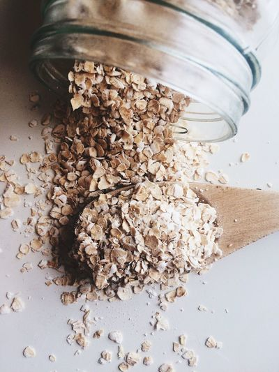 Spilled oats Jar Healthy Eating Oats - Food Raw Food Food And Drink Granola Indoors  No People Spilling Ground Coffee Table Oat Flake Close-up Food Day Flatlay Flat Lay Food Flat Lays Oats Oatmeal Cooking Ingredient Raw Ingredients Ingredient Ingredients Spilled