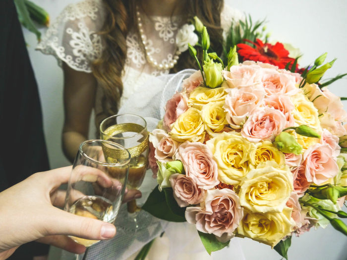 wedding bouquet Bouquet Bride Celebration Celebration Event Ceremony Champagne Champagne Flute Close-up Flower Food And Drink Freshness Holding Human Hand Indoors  Life Events Love Midsection Real People Rose - Flower Togetherness Wedding Wedding Cake Wedding Ceremony Wedding Dress Women
