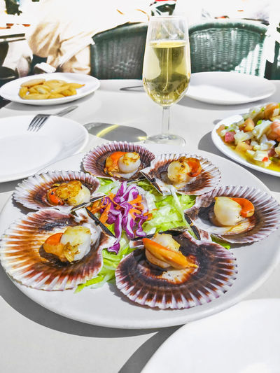 Scallops Iberic Zamburiñas Galician Exquisite Seafood Food Fresh White Healthy Plate SHELLFISH  Gourmet Dinner Fish Restaurant Appetizer Grilled Delicious Cooking Cooked Meal Olive Oil Closeup Nutrition Baked Cuisine Mollusk Tasty Fried Seashell Top Dining Natural Mollusk Shell Spanish Coral Roé Recipe North Sea Galicia Dish Dishes Famous Santiago De Compostela SPAIN Taste Tapas Wine
