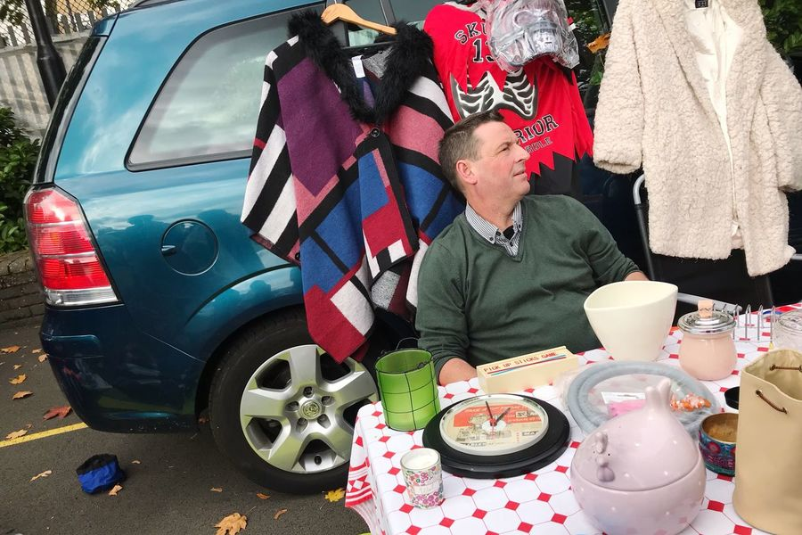 Battersea car boot sale Plate Day Adult Mature Adult Only Men Men Adults Only Outdoors Real People People Domestic Life Lifestyles Standing Working Warm Clothing Young Adult London Car Boot Sale Battersea Car Boot Sale