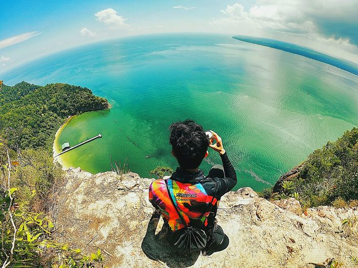 Seat, Relax and enjoying the view - Atai Hiking Ocean Mountain Mothernature Hike Outdoors Wildlife Tree Sunrise Friendship Colleague Sport EyeEmNewHere Beauty In Nature Nature Sea Bestmoment Relaxing Fresh Cool Cocacola Scenery Gopro Water Sea Beach Sky
