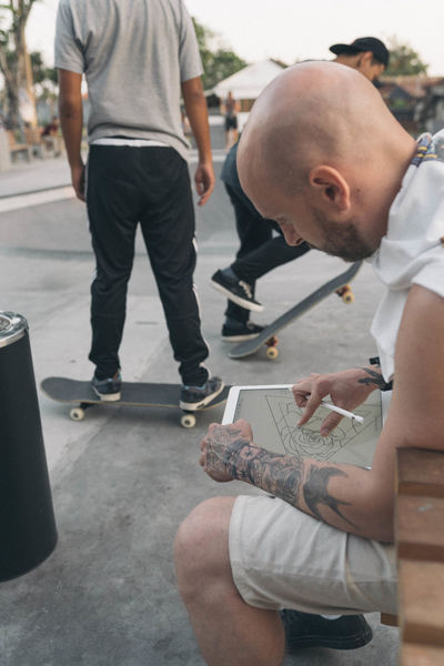 Artist Skateboarding Day Drawing Ipad Pro Outdoors Real People Tattoo Tattoos Two People Young Adult