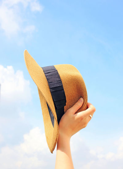 Human Hand Sky Hand Cloud - Sky One Person Human Body Part Real People Holding Lifestyles Unrecognizable Person Day Low Angle View Nature Leisure Activity Body Part Clothing Hat Focus On Foreground Personal Perspective Finger Summer Summertime Fashion