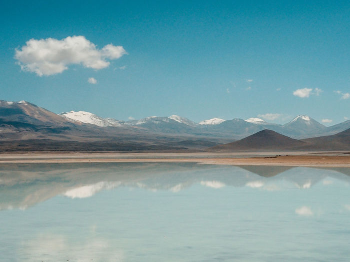 Driving through the Bolivian desert. Beauty In Nature Cloud - Sky Day Environment Idyllic Lake Landscape Mountain Mountain Range Nature No People Outdoors Reflection Salt Flat Scenics - Nature Sky Tranquil Scene Tranquility Water