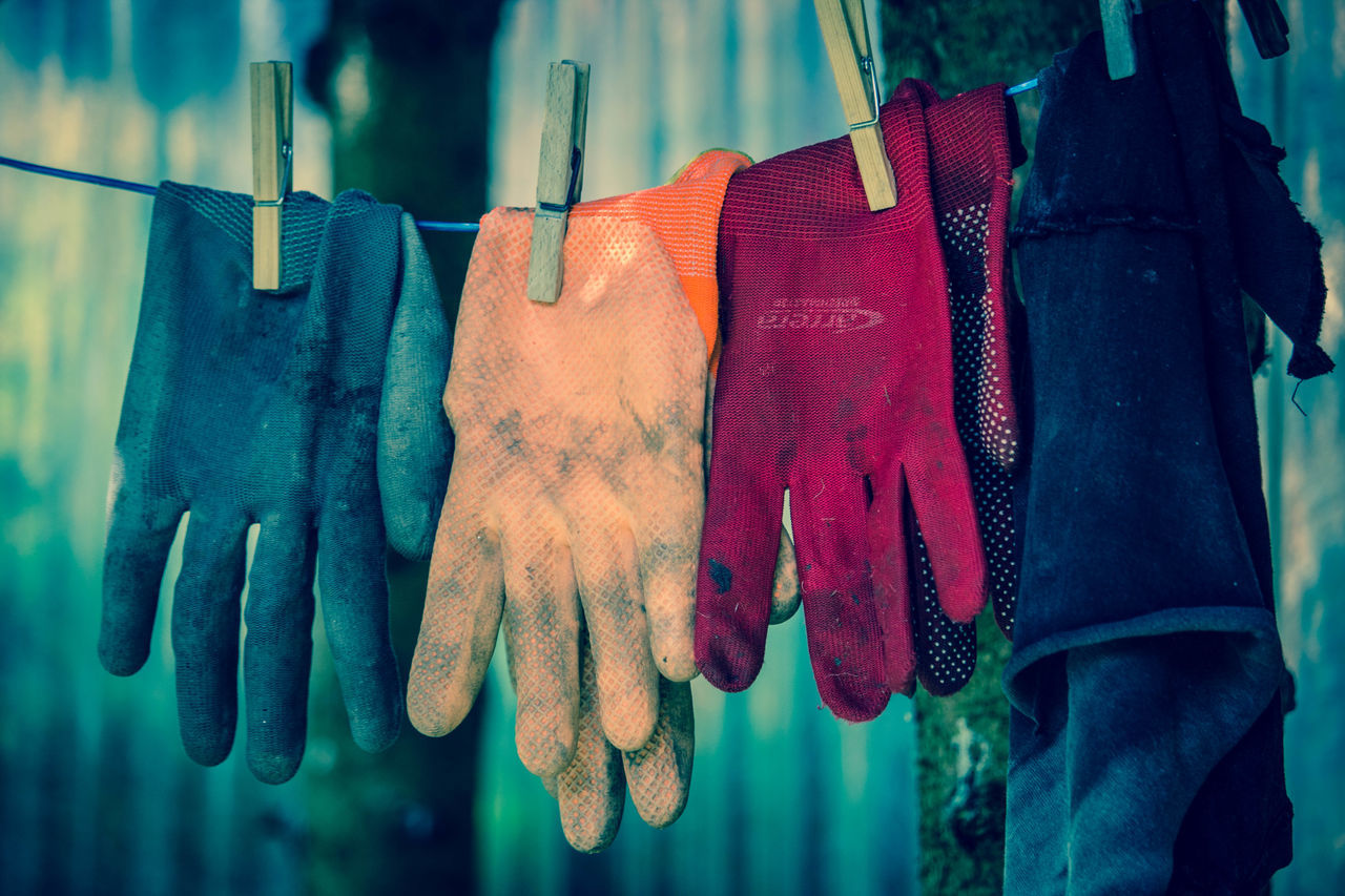 Close-Up Of Colorful Gloves Drying On Clothesline