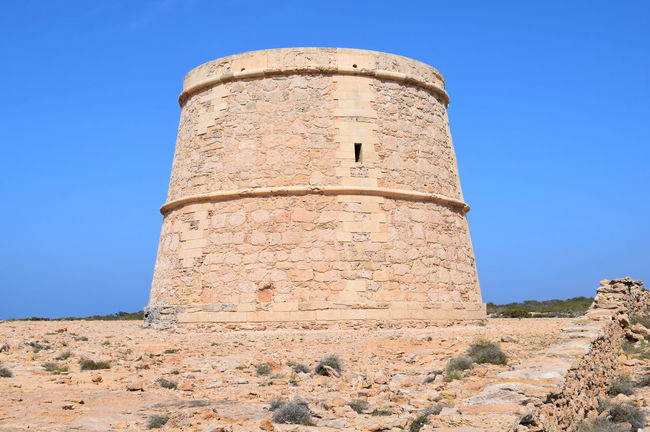 Torre des Garroveret Formentera Formentera Formentera Island Ibiza Rural Torre Des Garroveret Watch Tower Architecture Baleares Balearic Islands Blue Built Structure Clear Sky Day Formentera Ibiza History Low Angle View Nature No People Outdoors Sky Watchtower