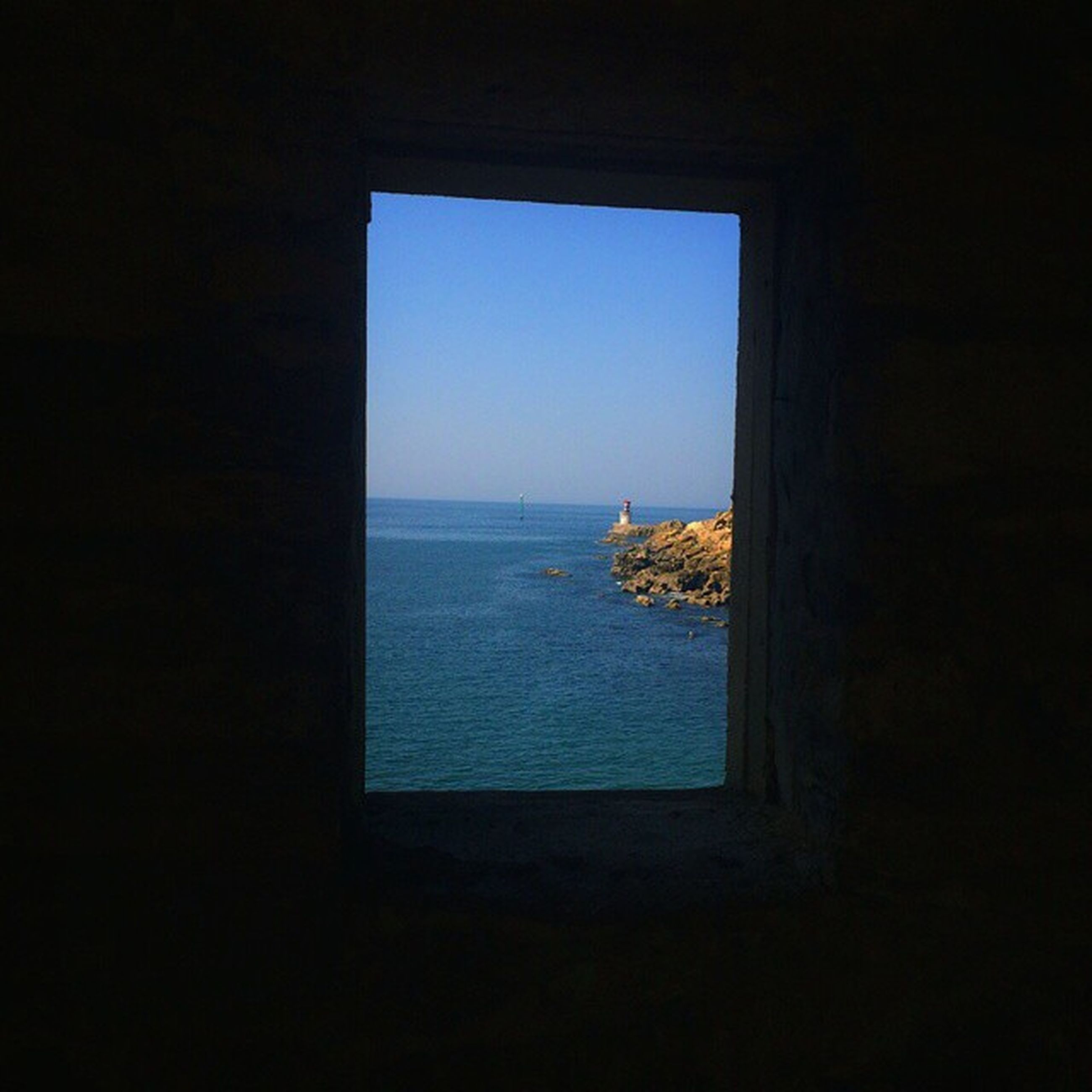 sea, horizon over water, water, indoors, window, clear sky, scenics, copy space, tranquil scene, tranquility, beauty in nature, nature, sky, blue, idyllic, seascape, beach, ocean, no people, day