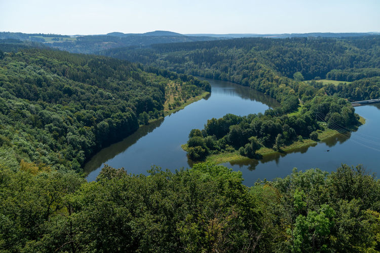 High angle view of river bend saale in forest against sky