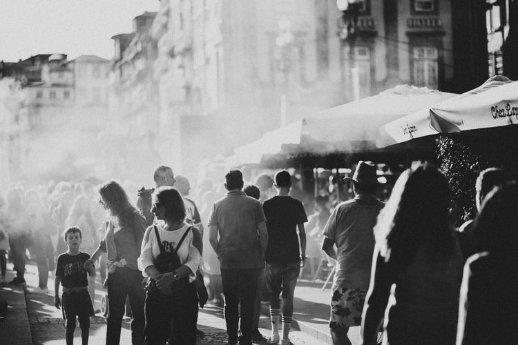 Group Of People City Large Group Of People Outdoors Lifestyles Walking Porto Portugal Streetphotography Travel Destinations Monochrome monochrome photography Human Hand Smoke Capture Tomorrow