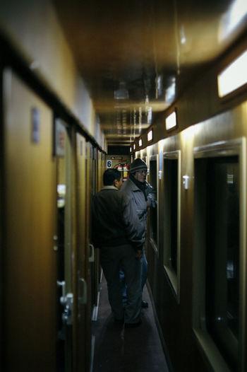 Full length of man standing in illuminated room