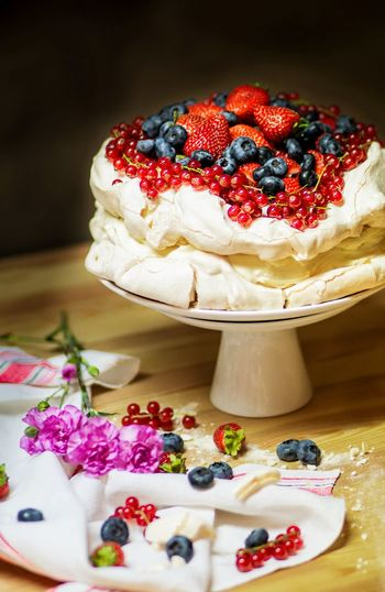 Close-up of pavlova cake with berry fruits