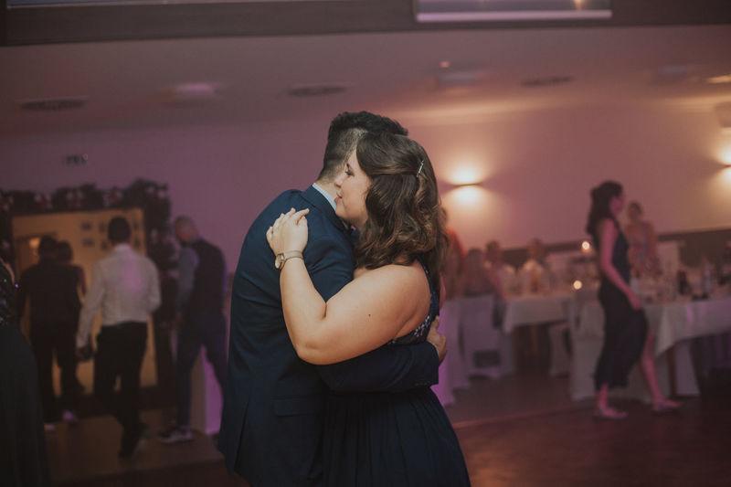 Heterosexual couple dancing together in party