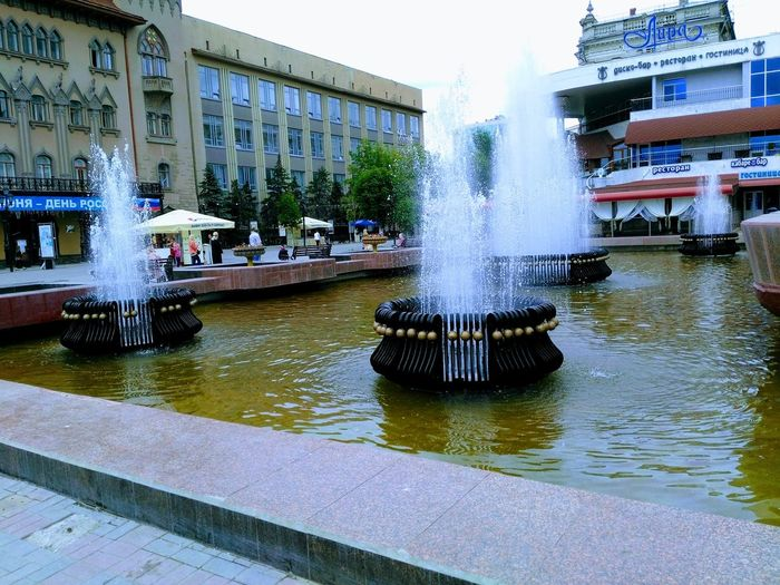 Water Fountain Splashing Spraying Architecture Motion Building Exterior Long Exposure Swimming Pool Wet Outdoors Built Structure Day City No People Flood Sky City Street Street Urban Cityscape Russia Architecture Conservatory Of Music