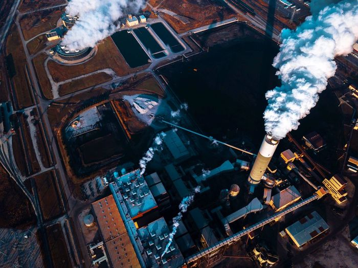 A furious power plant burns thousands of tons of coal Pollution Dramatic Drone Photography Drone  Dronephotography EyeEm Selects Building Exterior Aerial View Architecture Water High Angle View City Built Structure No People Cityscape Transportation Industry Nature Building Outdoors Day Travel Sea Travel Destinations Skyscraper Office Building Exterior