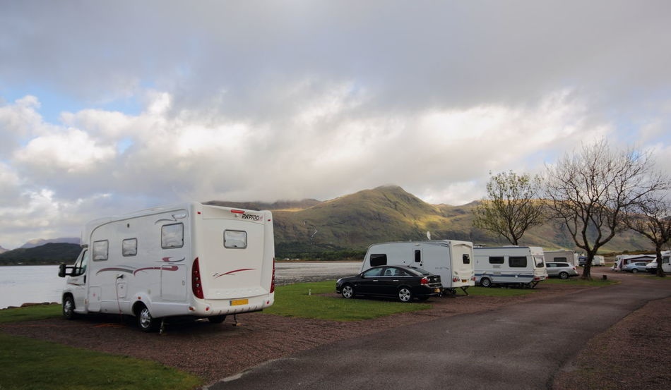 Car Caravan Caravanning Cloud Composition Day Direction Guidance Journey Loch Linnhe Mode Of Transport Motorhome No People Outdoors Overcast Perspective Road Sign Sky The Tourist The Way Forward Transportation Vehicle