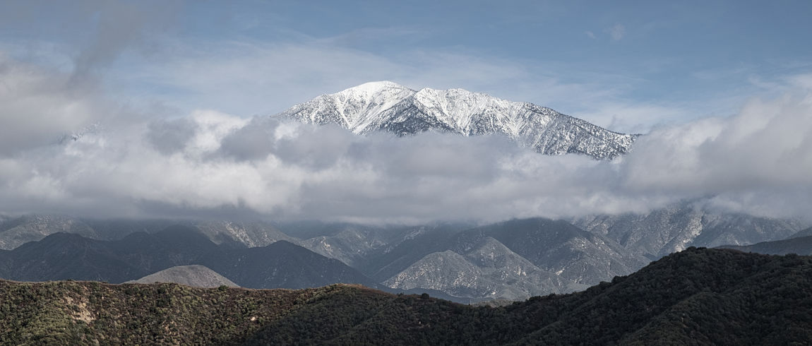 The crown jewel of the San Gabriel Mountains creates it's own weather system. Beauty In Nature Cloud - Sky Cold Temperature Day Fog Forest Landscape Mountain Mountain Peak Mountain Range Nature No People Outdoors Scenics Sky Snow Snowcapped Mountain Tranquility Travel Destinations Winter