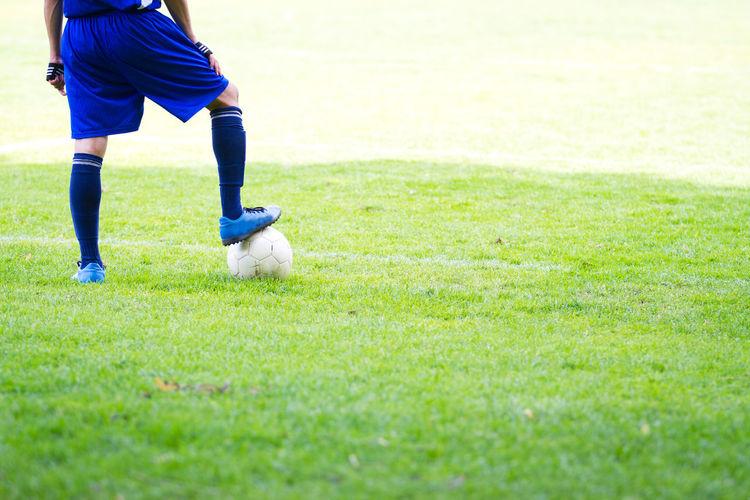 Full length of child on field