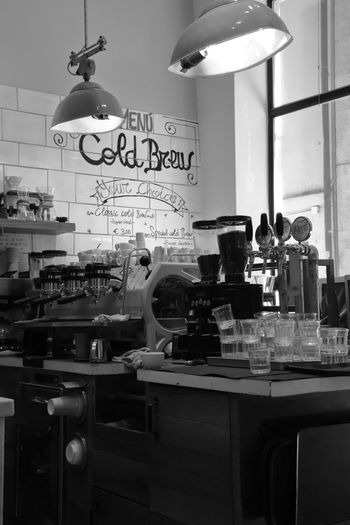 Coffee in black and white High Angle View Inspirational Drink Coffee Moments Shadows & Lights Canon5Dmk3 Italy Photooftheday Blackandwhite Good Morning Bistro Text Western Script Business Indoors  No People Communication Food And Drink Glass - Material Bar - Drink Establishment Glass Lighting Equipment Table