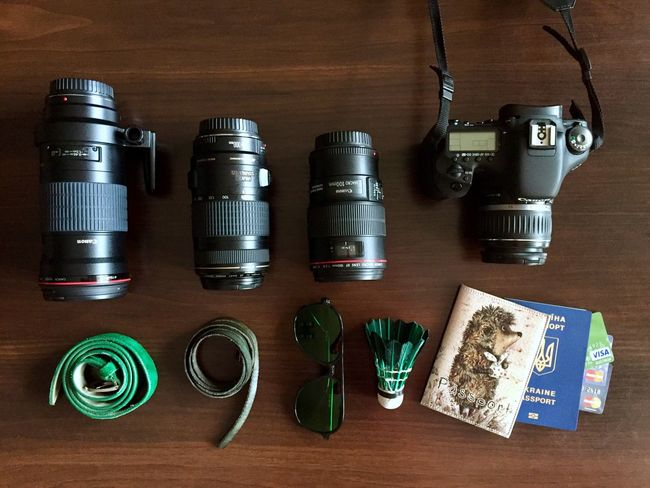 Ready for the travel Travel Item Photography Items On A Table Lens Camera Camera - Photographic Equipment Passports Sunglasses Cards
