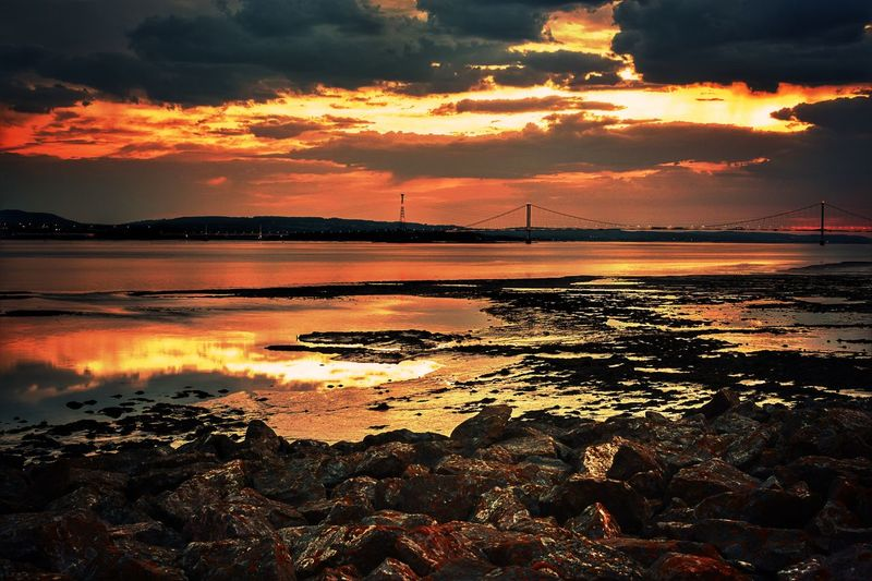 Sunset Water Scenics Cloud - Sky Tranquil Scene Tourism Tranquility Travel Destinations Beauty In Nature Beach Nature Reflection Bridge - Man Made Structure Sea Sky Non-urban Scene Atmosphere Vacations Distant Dramatic Sky