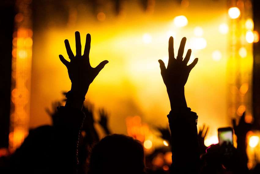Arms Raised Arts Culture And Entertainment Audience Concert Crowd Enjoyment Event Festival Group Of People Hand Hand Raised Human Arm Human Body Part Human Hand Illuminated Lighting Equipment Music Music Festival Night Nightlife Performance Positive Emotion Real People Silhouette Youth Culture