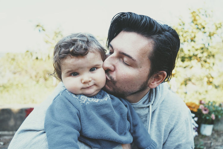 Portrait of father with baby