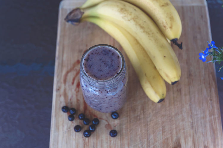 Blueberry Smoothie Banana Banana Peel Blueberry Close-up Day Food Food And Drink Freshness Fruit Healthy Eating High Angle View Indoors  No People Smoothie Table Wood - Material