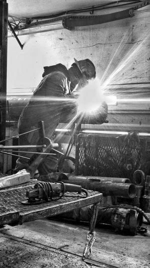 Men Working Protective Workwear Welding People Only Men Welder One Man Only Working Man Working Hard Menatwork Blackandwhite Industrial Miner Industry Blue Collar Workingman High Contrast Welding Architecture Work Place