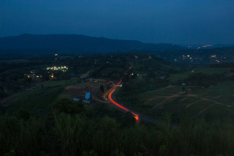 High angle view of light trails on road against sky at night