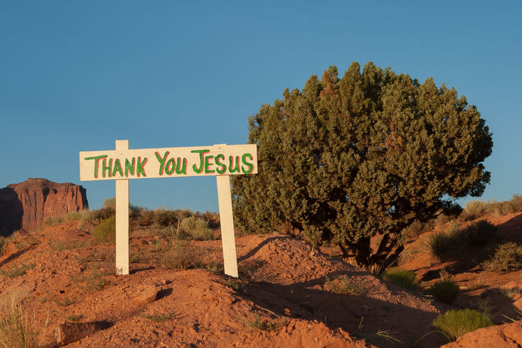 Roadside signs in Monument Valley America Americana Arizona Communication Copy Space Information Sign Jesus Lord Message Non-urban Scene Outdoors Religion Road Trip Roadside Roadside America Roadtrip Rural Rural Scene Sign Sign United States USA Utah Western Script