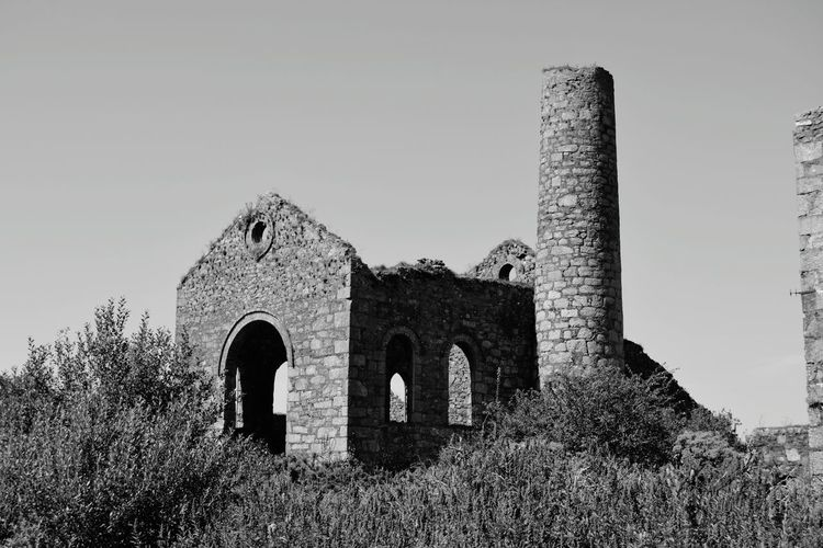 Chimney Stacks Building Exterior History Architecture Old Ruin Arch Ancient The Past Outdoors No People Blackandwhite Photography Cornish Tin Mine Black & White Built Structure Blackandwhite Cornwall Uk Cornishmine Cornwall Rural Scene Day Architecture Ancient Clear Sky Sky