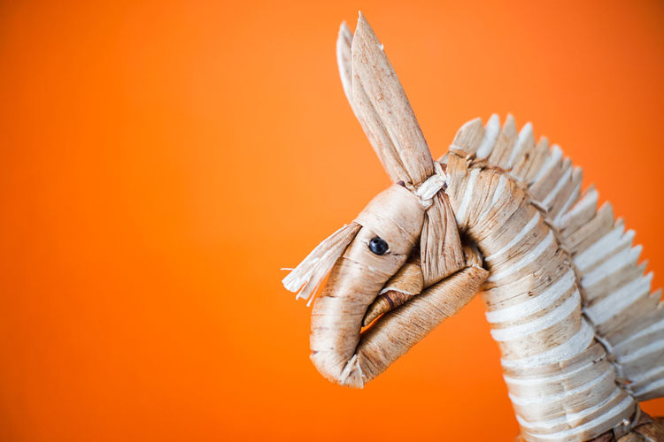 Horse with orange wall. 7artisans manual lens 25mm/f1.8 Thai Thailand Weave Animal Wildlife Close Up Close-up Colored Background Copy Space Gift Handcraft Handmade Horse Indoors  Local Handcrafts No People Orange Background Orange Color Representation Single Object Souvenir Studio Shot Thai Food Toy The Photojournalist - 2018 EyeEm Awards The Street Photographer - 2018 EyeEm Awards The Architect - 2018 EyeEm Awards