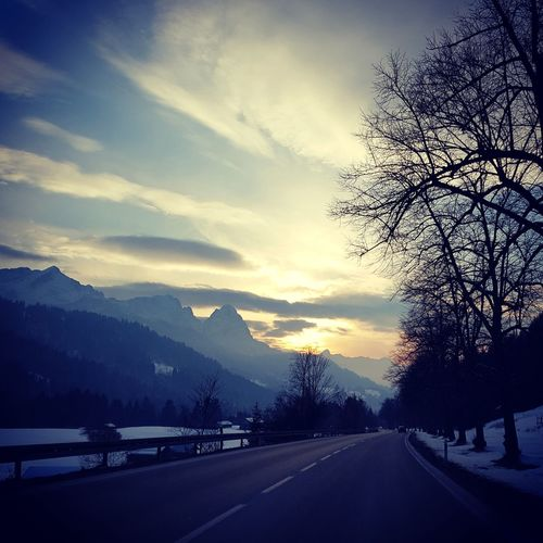 Deutschland Germany Bayern Zugspitze Alpspitze Waxenstein Sunset Snow Road Tree Mountain The Way Forward Transportation Landscape Sky Cold Temperature Beauty In Nature Outdoors No People Sunlight Winter