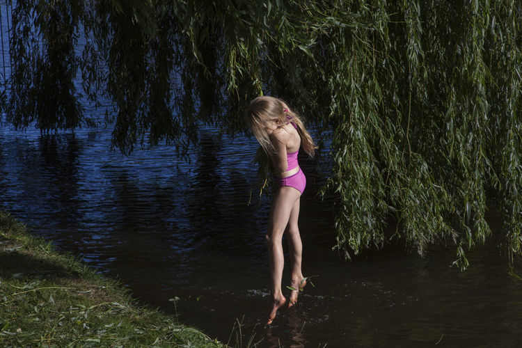 www.instagram.com/hrudography Amsterdam Children Bikini Child Day Full Length Grass Kid Lake Leisure Activity Lifestyles Nature One Person Outdoors People Real People Standing Streetphotographer Streetphotography Tree Water Waterfront