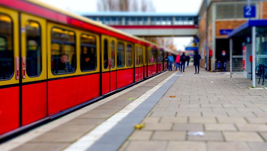 Tilt-shift image of train at railroad station